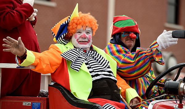 CK Clowns from Pittsburg's Mirza Temple wave to the crowd during the Baxter Springs Christmas Parade on Saturday in downtown Baxter Springs. Globe | Laurie Sisk