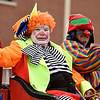 CK Clowns from Pittsburg's Mirza Temple wave to the crowd during the Baxter Springs Christmas Parade on Saturday in downtown Baxter Springs.<br /> Globe | Laurie Sisk