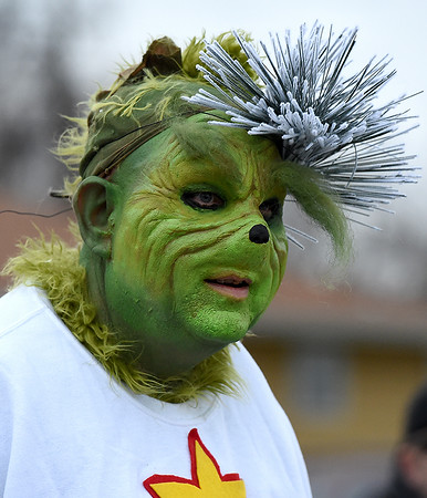 The Grinch makes his way down the parade route during the Galena Christmas Parade on Saturday in downtown Galena.<br /> Globe | Laurie Sisk