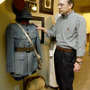 World War I collector Shannon Kelly stands beside a French artillery officer's uniform - just one of countless items Kelly has collected since he was nine years old.<br /> Globe | Laurie Sisk