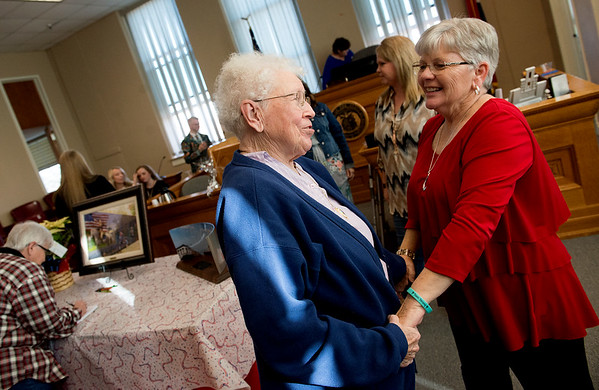 Marjorie Bull, former Jasper County Clerk, left, congratulates Marilyn Baugh, current Jasper County Clerk, on her retirement during a party for Baugh on Monday at the Jasper County Courthouse in Carthage.<br /> Globe | Roger Nomer