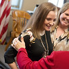 Sami Bayless and her mother Charity talk with friends during a retirement party for Sami's grandmother in Carthage on Monday, Dec. 12. Following Sami's accident, the community has rallied around the Bayless family with support and donations.<br /> Globe | Roger Nomer