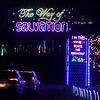 Cars wait their turn to enter the Way of Salvation Christmas light display on Wednesday night at the Congregation of the Mother of the Redeemer in Carthage.<br /> Globe | Laurie Sisk