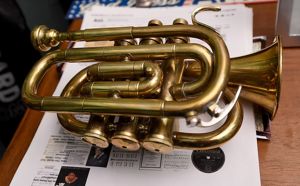 A pocket Cornet lays on a table inside Bruce Benson's home in Webb City. The instrument is one of several the veteran collects.<br /> Globe | Laurie Sisk