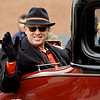 Rick White, Grand Marshall for the Baxter Springs Christmas Parade, waves to the crowd during the parade on Saturday in downtown Baxter Springs.<br /> Globe | Laurie Sisk
