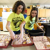 From the left: Neosho High School junior Kyndall Davidson and NHS senior Jada Twictchell help restock sandwiches for players in one of four hospitality rooms during the 2018 Neosho Holiday Classic on Thursday afternoon at NHS. More than 40 volunteers help feed players, coaches, media and officials after each game in the tournament.<br /> Globe | Laurie Sisk
