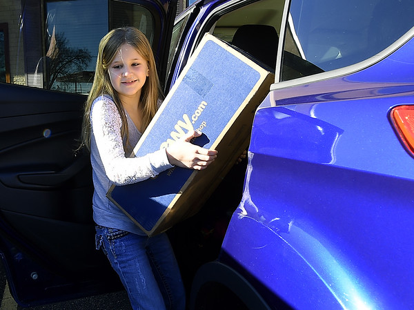 Hannah White, who turns 8 years old on Dec. 21, delivers 120 of the more than 500 blankets she collected to the Caring Closet on Saturday morning in Carl Junction. In lieu of birthday presents this year, White decided she'd like to collect blankets to donate to various local charities.<br /> Globe | Laurie Sisk