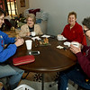 From the left: Tami Brumbaugh, Sharon Barone, Susie Polhlopek and Deb Williams enjoy hot drinks and warm conversation on Friday at The Root Coffehouse and Creperie in Pittsburg. The coffeehouse is part of the Block 22 project.<br /> Globe | Laurie Sisk