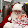 Santa pays his annual visit to the Freeman NICU on Friday morning, holding twins Remi, left, and Houston Edgerton who were born on Dec. 12.<br /> Photo Courtesy Freeman Health System