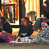 Spectators enjoy warm drinks, blankets and conversation as they await the start of the 2018 Christmas Parade on Tuesday night in Downtown Joplin.<br /> Globe | Laurie Sisk