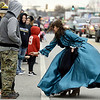 Brittany Odom, of the United Daughters of the Confederacy, hands candy to kids during the Baxter Springs Christmas Parade on Saturday in downtown Baxter Springs.<br /> Globe | Laurie Sisk