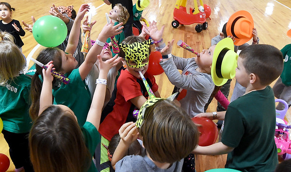 Youngsters revel in the New Year spirit during the Toddlers New Years celebration on Thursday at Roller City. The event featured a balloon drop with prizes, games and more for children six and under.<br /> Globe | Laurie Sisk