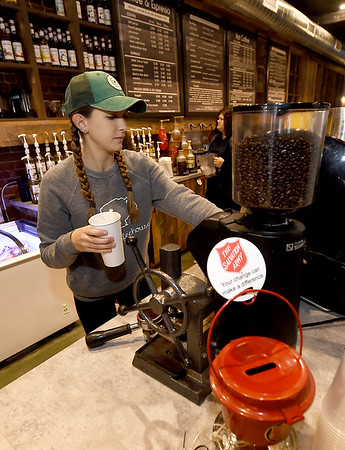 Taylor Whitley serves a fresh caramel macchiato on Friday at The Root Coffehouse and Creperie in Pittsburg. The coffeehouse is part of the Block 22 project.<br /> Globe | Laurie Sisk