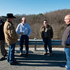 (from left) Rep. Bill Lant, presiding McDonald County commissioner elect, John Bunch, eastern McDonald County commissioner, Keith Lindquist, presiding McDonald County commissioner, David Holloway, associate McDonald County commissioner, and Gregg Sweeten, Pineville mayor, talk about completion of the bypass on the Missouri side on Monday.<br /> Globe | Roger Nomer