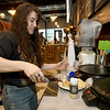 Barista Rachel Grotheer drizzles syrup on fresh crepes on Friday at The Root Coffehouse and Creperie in Pittsburg. The coffeehouse is part of the Block 22 project.<br /> Globe | Laurie Sisk
