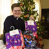 Easton Mudock poses at his home with some of the thousands of pajamas he has donated to hospitals throughout the country.<br /> Globe | Laurie SIsk