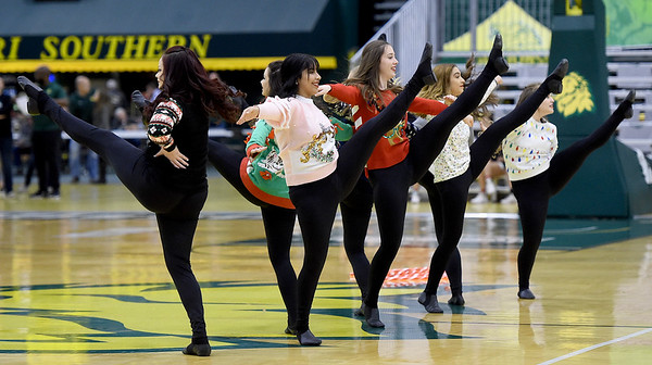 Members of the Missouri Southern Gold Dance Team spread a little Holiday cheer as they entertain the crowd during the MSSU-Northeastern State basketball game on Saturday at Leggett & Platt.<br /> Globe | Laurie SIsk