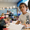 Kobe Hayes checks examples of cursive letters during class in third grade at Kelsey Norman Elementary on Thursday.<br /> Globe | Roger Nomer