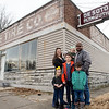 For Caleb Patrick and his family (from left) Thea, 3, Annie, Nyah, 6 months, Ephraim, 8, Ruth, 2, and Cohen, 6, cleaning up the former De Soto car plant in Carthage is a family project.<br /> Globe | Roger Nomer
