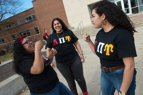 (from left) Natalie Vasquez, a Pittsburg State University junior from Kansas City, Kan., Samantha Ruvalcaba, a PSU junior from Wichita, Kan., and Cassandra Roque, a PSU senior from Westwood, Kan., practice the handshake for Lambda Pi Upsilon Sorority on Thursday at PSU.<br /> Globe | Roger Nomer