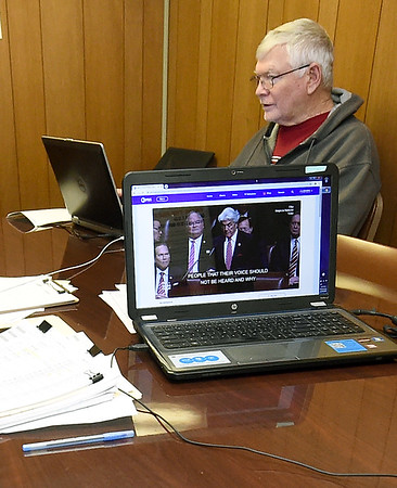 SWMO Democrats volunteer Hugh Shields watches the impeachment proceedings on Wednesday at the SWMO Democrats headquarters.<br /> Globe | Laurie Sisk