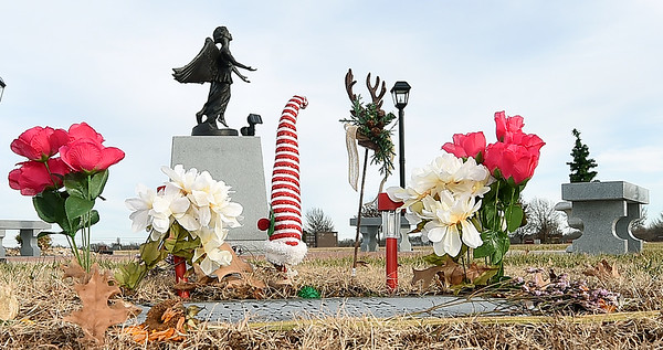 A child's final resting place lay decorated near the Angel of Hope in the Garden of Angels at Miami's G.A.R. Cemetery on Wednesday. The 2nd Annual Angel of Hope Candlelight Remembrance Ceremony will be Friday at 7 p.m. at the cemetery.<br /> Globe | Laurie Sisk