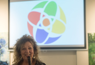 Linda Teeter talks about the pinwheel design of the new Joplin Art District logo on Wednesday at the Spiva Center for the Arts. Globe | Roger Nomer