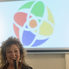 Linda Teeter talks about the pinwheel design of the new Joplin Art District logo on Wednesday at the Spiva Center for the Arts.<br /> Globe | Roger Nomer