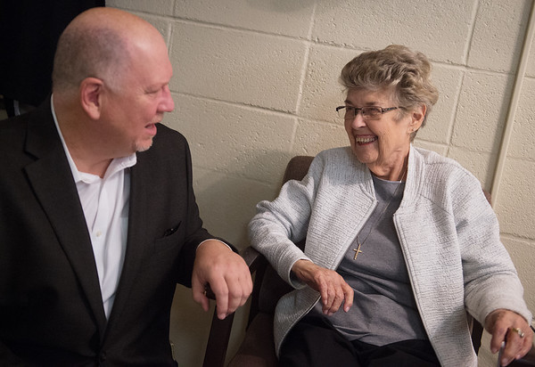 Russell Willoughby, senior minister at the First Community Church, talks with Mary Ann Edwards during the church's annual Christmas meal on Wednesday. Edwards, her husband and a few other members helped start the meal 45 years ago.<br /> Globe | Roger Nomer