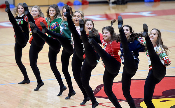 Dressed in festive Christmas sweaters, members of the Webb City High School Redettes dance team entertain the crowd with a holiday-themed performance during halftime of the WCHS/McDonald County girls basketball game on Tuesday night at the Cardinal Dome.<br /> Globe | Laurie SIsk