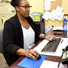 Brittany Caine, the new nutrition director for the Area Agency on Aging, works in her office at the agency on Tuesday. Caine is replacing outgoing director Stephanie Denham.<br /> Globe | Laurie SIsk