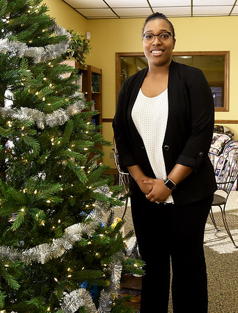 Brittany Caine, the new nutrition director for the Area Agency on Aging, stands in the lobby of the agency on Tuesday. Caine is replacing outgoing director Stephanie Denham.<br /> Globe | Laurie SIsk