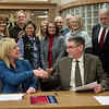 Melinda Moss, superintendent of Joplin, shakes hands with Dan Pekarek, Joplin interim city manager, after signing an agreement for the transfer of Dover Hill Park to the school district on Monday at Joplin City Hall.<br /> Globe | Roger Nomer