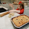 Sven-year-old Austynn Asbell pitches in at her Carl Junction home as her family bakes pies for their annual community Christmas dinner at the Carl Junction Community Center.<br /> Globe | Laurie Sisk