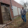 Caleb Patrick talks about cleaning up the former De Soto car plant in Carthage on Friday.<br /> Globe | Roger Nomer