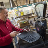 On Thursday, Ray Mathis demonstrates an antique scale, made in 1890, that will be sold with Carthage Hardware.<br /> Globe | Roger Nomer