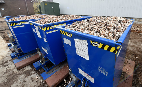 Large bins of mushroom pieces await use by local cattle operations at J-M Farms in Miami on Friday. <br /> Globe | Laurie SIsk