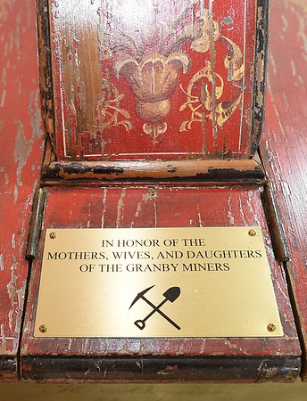 Homage is payed to local miners' families on a plaque attached to the centennial wheelbarrow.<br /> Globe | Laurie Sisk