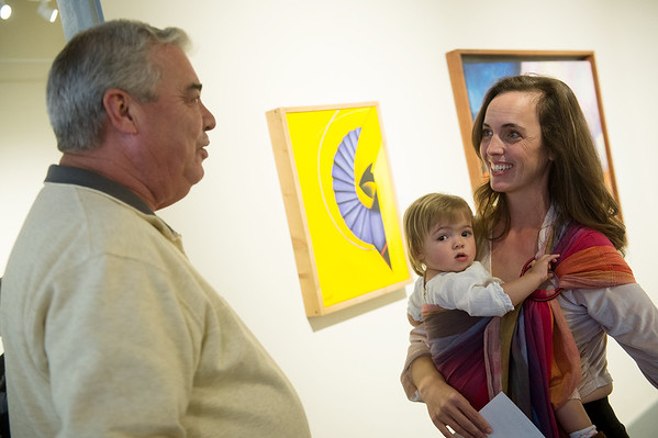 Trisha Patton Wingebach, accompanied by Cora, 14 months, talks with Paul Whitehill after the unveiling of the Joplin Arts District logo on Wednesday at the Spiva Center for the Arts. Patton Wingebach is the designer of the new logo. Globe | Roger Nomer