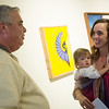 Trisha Patton Wingebach, accompanied by Cora, 14 months, talks with Paul Whitehill after the unveiling of the Joplin Arts District logo on Wednesday at the Spiva Center for the Arts. Patton Wingebach is the designer of the new logo.<br /> Globe | Roger Nomer