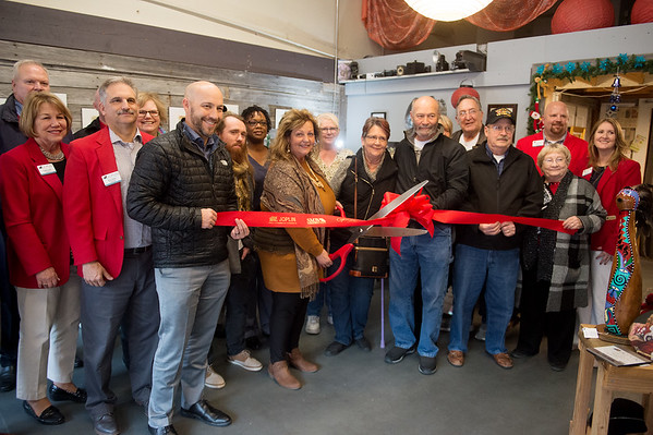 Linda Teeter, owner of Urban Art Gallery, cuts the ribbon to celebrate the gallery's fourth year of business and new membership in the Joplin Area Chamber of Commerce on Monday in downtown Joplin.<br /> Globe | Roger Nomer