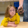 Brecklyn Martin, 5, watches intently as Kim Bartlett, with the CJ Cultivators, demonstrates how to make a seed ball on Friday at the Footprints and Friends Preschool.<br /> Globe | Roger Nomer