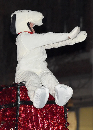 A fan favorite throughout the ages, Snoopy waves to the crowd atop the SMB float during the 49th Annual Joplin Christmas Parade on Tuesday night in downtown Joplin.<br /> Globe   Laurie Sisk