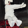 A fan favorite throughout the ages, Snoopy waves to the crowd atop the SMB float during the 49th Annual Joplin Christmas Parade on Tuesday night in downtown Joplin.<br /> Globe | Laurie Sisk