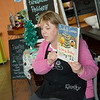 Charity Hawkins, owner of Firehouse Pottery, reads a holiday book for Storytime Pottery on Tuesday at the pottery studio. Children also got the chance to design their own pottery Christmas ornaments.<br /> Globe | Roger Nomer