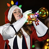 A trumpet player for the Joplin High School Band sports a colorful array of lights during the 49th Annual Joplin Christmas Parade on Tuesday night in downtown Joplin.<br /> Globe | Laurie Sisk