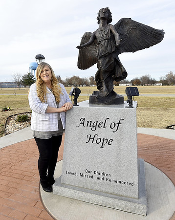 Nancy Bro, G.A.R. Cemtery office manager, stands near The Angel of Hope statue in the Garden of Angels at Miami's G.A.R. Cemetery on Wednesday. The 2nd Annual Angel of Hope Candlelight Remembrance Ceremony will be Friday at 7 p.m. at the cemetery. Globe | Laurie Sisk