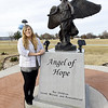 Nancy Bro, G.A.R. Cemtery office manager, stands near The Angel of Hope statue in the Garden of Angels at Miami's G.A.R. Cemetery on Wednesday. The 2nd Annual Angel of Hope Candlelight Remembrance Ceremony will be Friday at 7 p.m. at the cemetery.<br /> Globe | Laurie Sisk