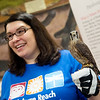 Delia Lister, director of Nature Reach at Pittsburg State University, holds Willow, an American Kestral, as she talks about the organization's mission on Friday.<br /> Globe | Roger Nomer