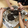 Children at Footprints and Friends Preschool create seed balls with Carl Junction Cultivators on Friday morning. The seed balls will be planted at the new Mammoth Prairie Park.<br /> Globe | Roger Nomer